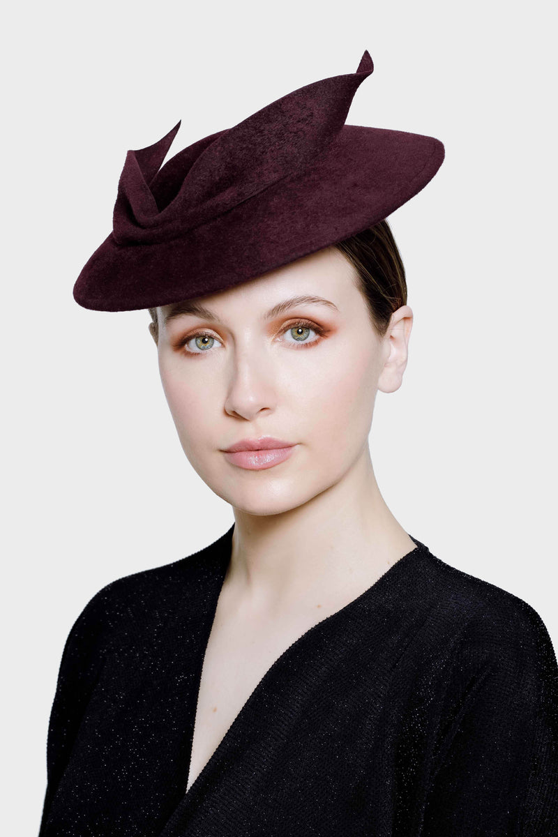 This elegant picture hat has an elegant leaf shape detail and a rose gold bead.   The Ceres picture hat would be the perfect choice for many special occasions such as attending weddings as a guest or mother of the bride, a cocktail soiree with friends or other formal event.  Each hat is made by hand.
