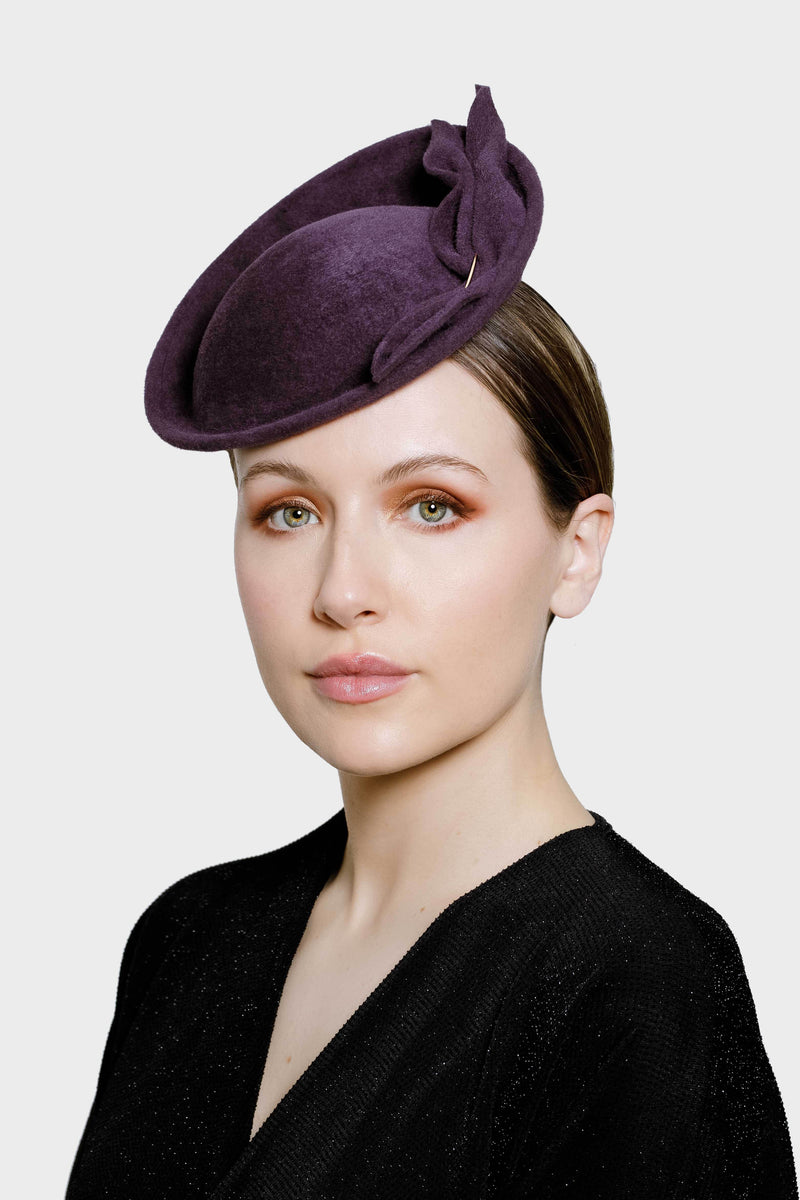 This elegant saucer percher hat has two elegant twist details and a rose gold bead.    The Radley saucer percher hat would be the perfect choice for our clients attending special occasions such as attending a wedding as a guest or mother of the bride or groom, a cocktail soiree with friends or other formal event.