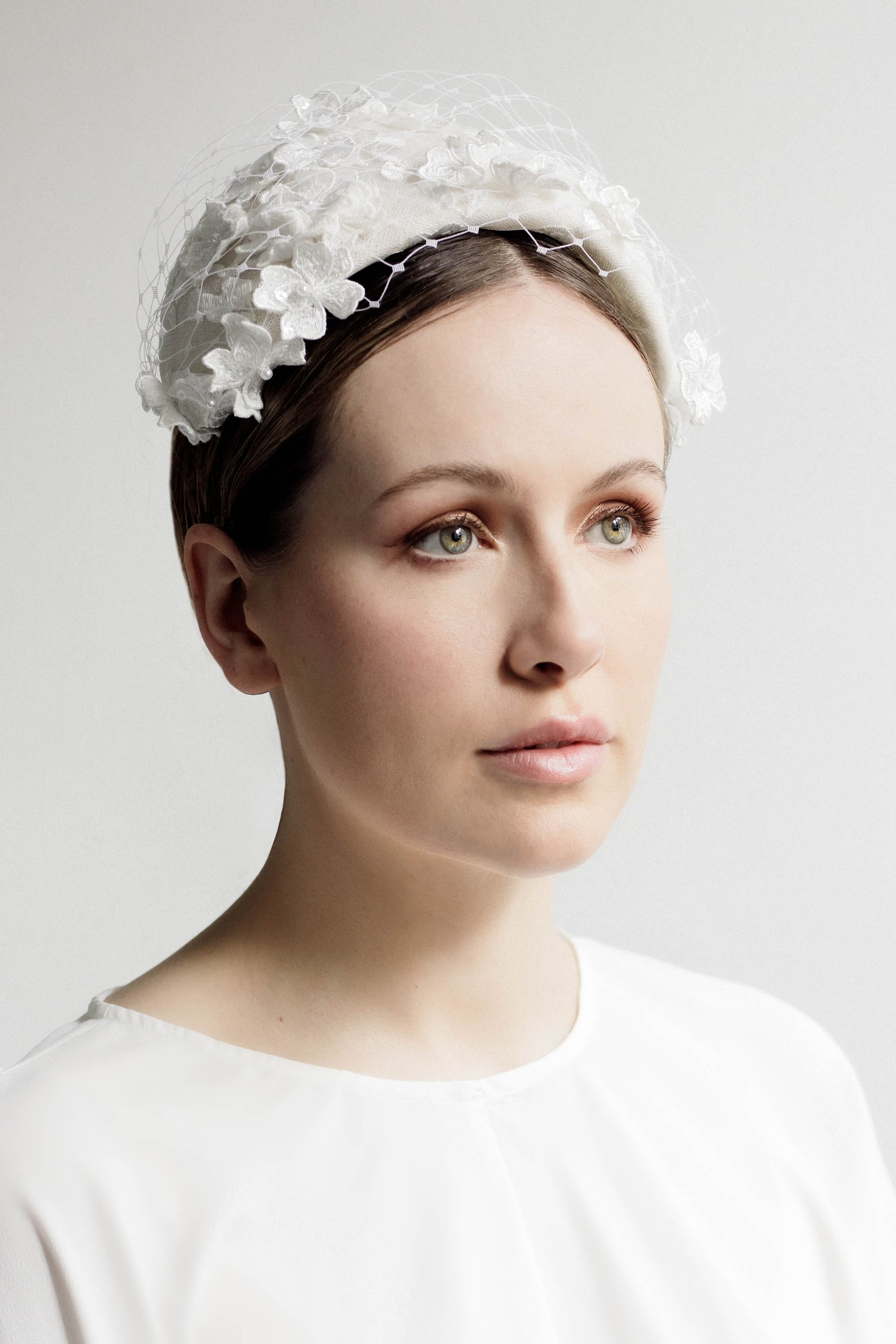 Our Ianthia  veil and lace floral headband is a romantic style, which can be worn with so many bridal looks. The headband is made from velour felt and the flowers are a beautiful lace, occasionally finished with a small faux pearl.