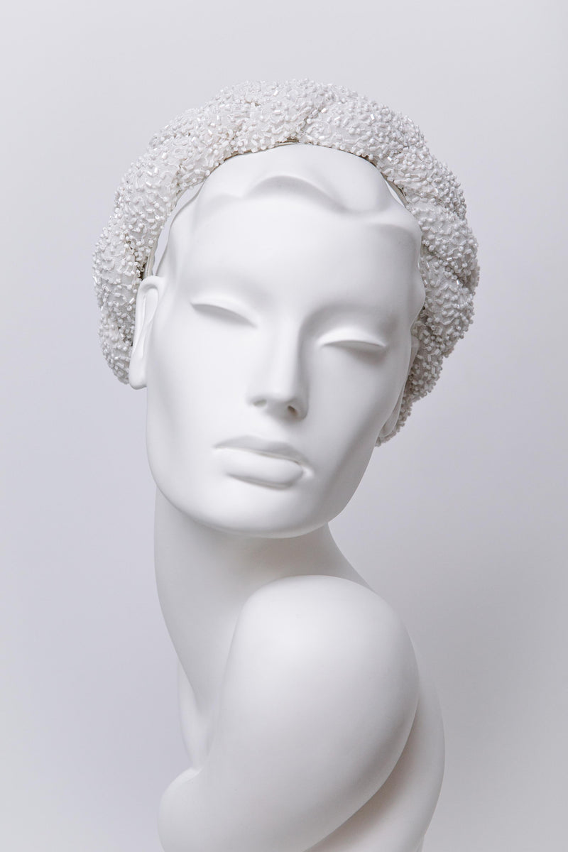 This elegant plaited beaded halo headband is made from a luxury beaded silk chiffon fabric, the headband is padded giving the headband volume.  The headband design is available in other bead colours. The halo headband has an inner headband making it very easy to wear. One Size.