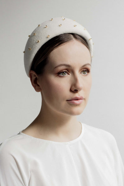 Amber is a beautiful felt beaded headband embellished with small gold coloured flower beads with Swarovski pearl centres.  This elegant beaded headband is perfect for the modern bride.