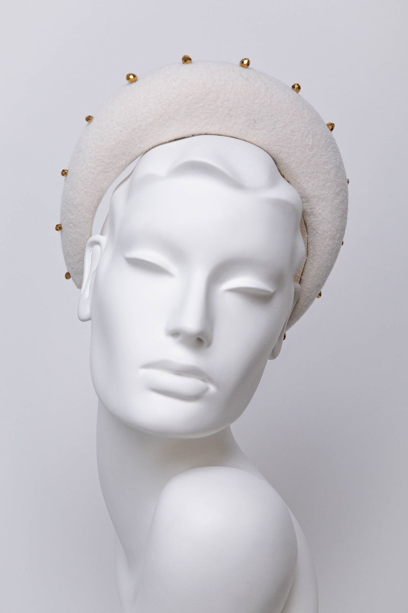 Karena is a modern halo headband.  This elegant beaded halo is made from velour felt, hand embellished with Gold coloured faceted beads.  This design is a modern reinvention of a classic style.