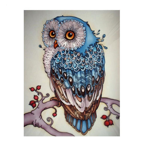 This is a photo of an owl drawing with blue peacock like feathers.