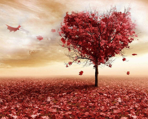 This is a photo of a heart shaped tree with red leaves.