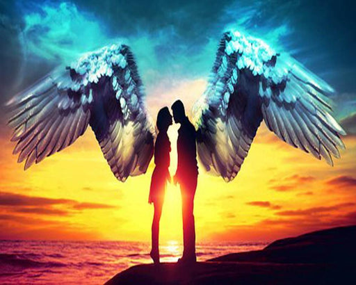 This is a photo of a man and woman angel kissing with a sunset background