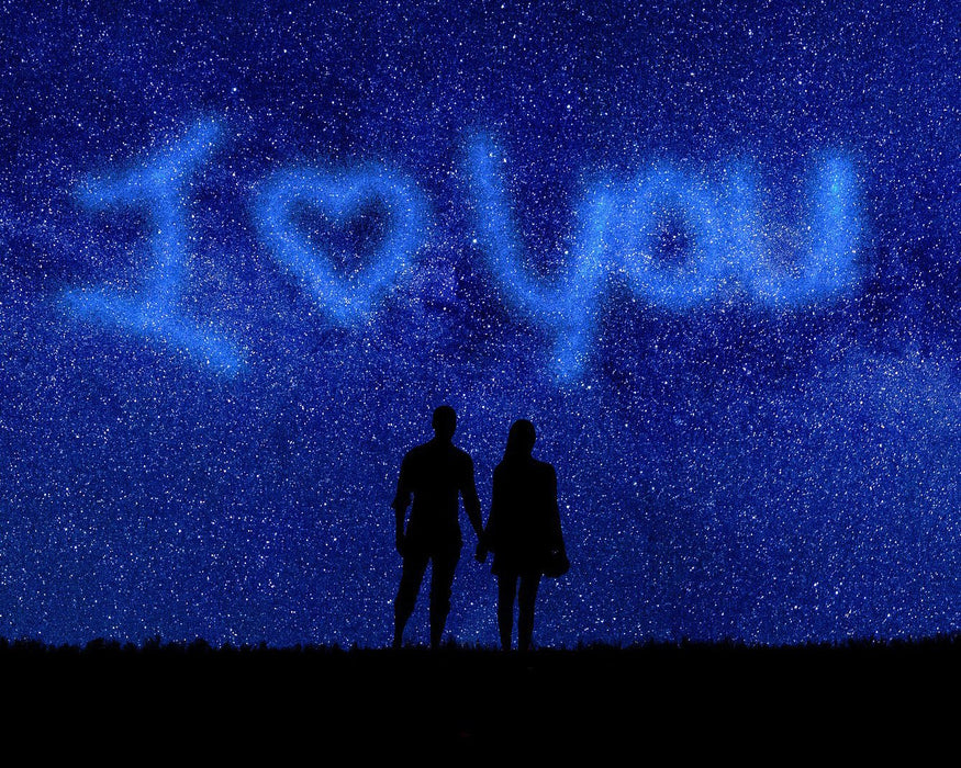 This is a photo of a couple silhouette on a starry night with I love you on the sky