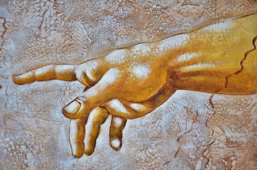 This is a photo of a painting of a hand reaching out.