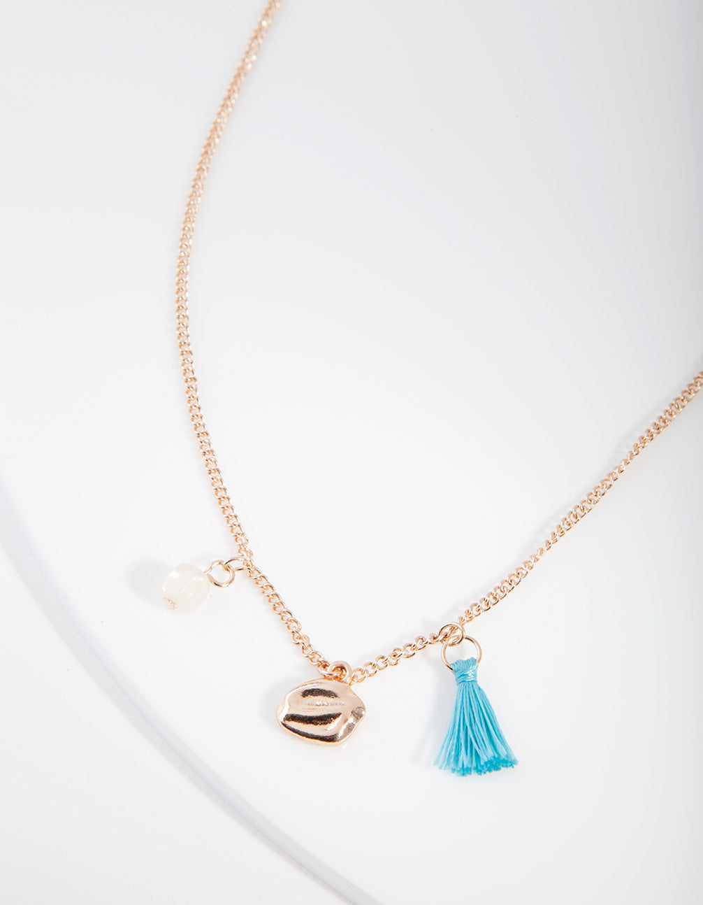 Gold Tassel Multi Charm Necklace