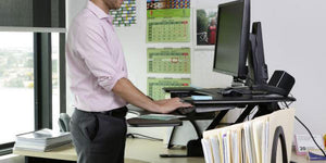 To stand or sit at your office desk?… that is the question