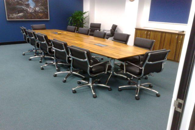 long boardroom table with chairs