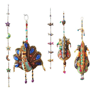 OMishka collection of beautifully and ethically handmade hanging tota decorations.