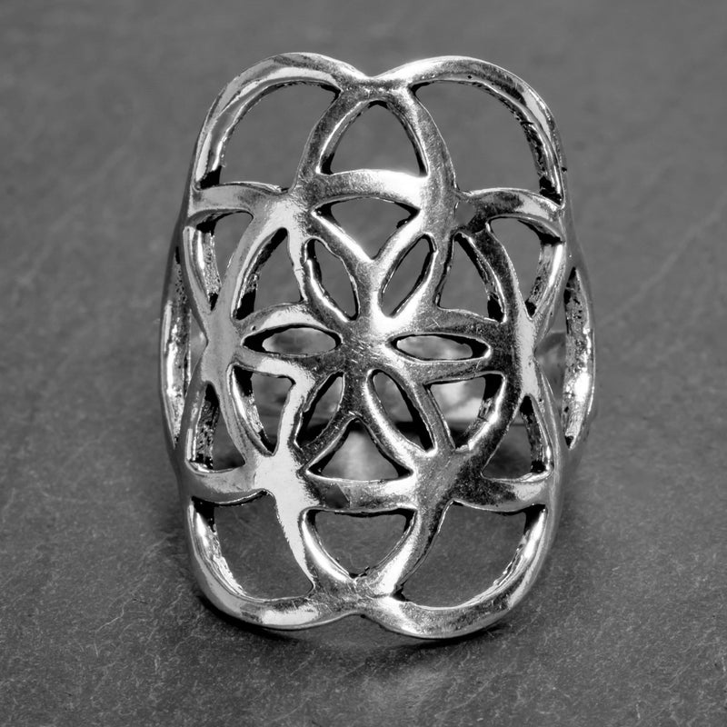 An adjustable, artisan handmade solid silver, seed of life ring designed by OMishka.