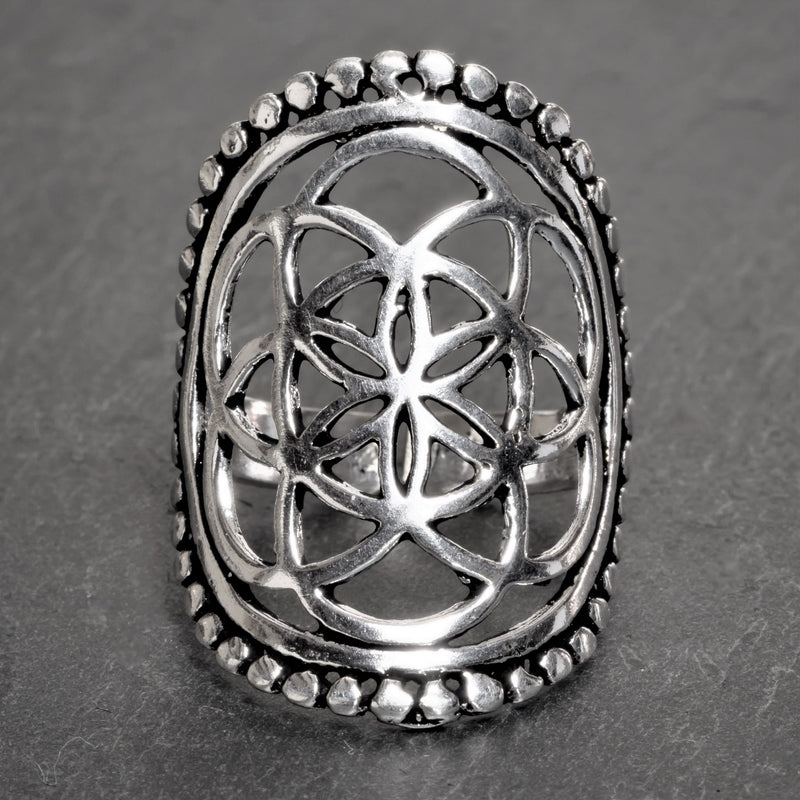 An adjustable, chunky, artisan handmade solid silver, beaded seed of life ring designed by OMishka.