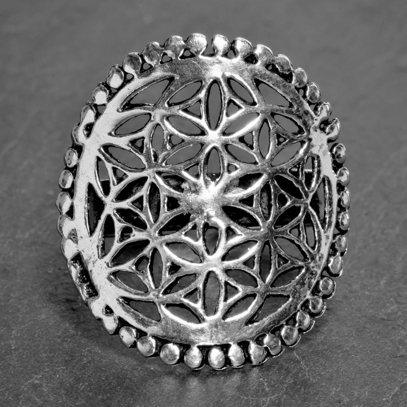 A large, adjustable, artisan handmade solid silver, beaded flower of life ring designed by OMishka.