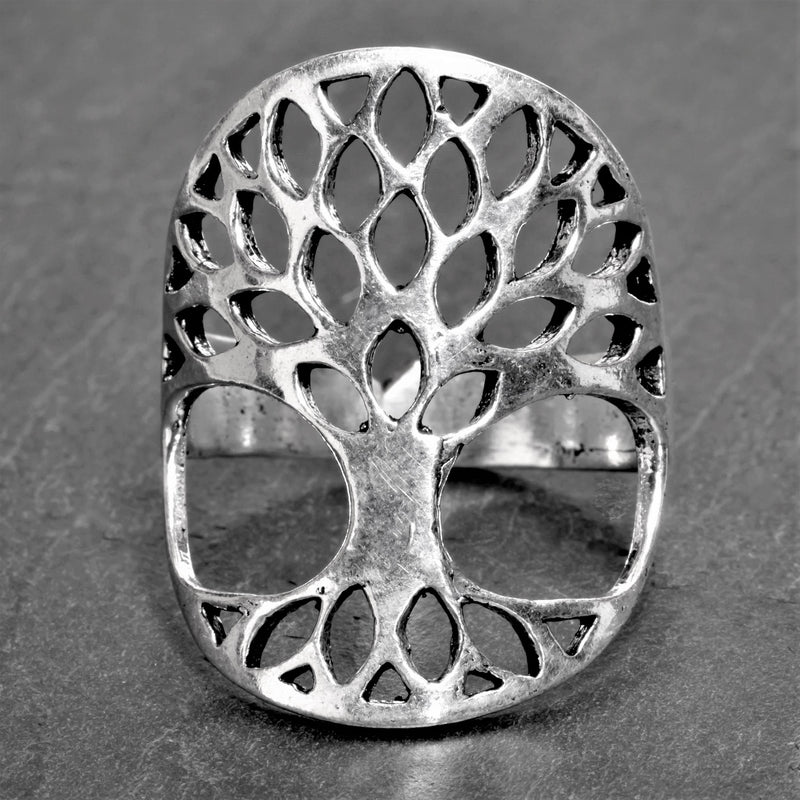 An adjustable, chunky, artisan handmade solid silver, tree of life ring designed by OMishka.