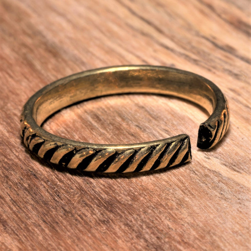 An adjustable, dainty pure brass striped band toe ring designed by OMishka.