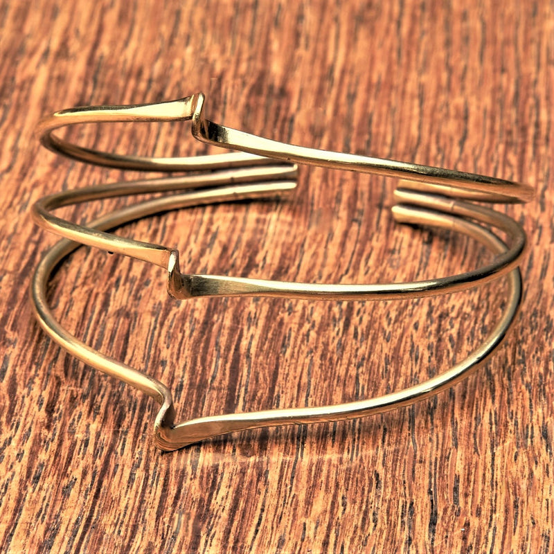 An adjustable, pure brass triple wave bracelet cuff designed by OMishka.