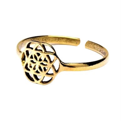 An adjustable, dainty, pure brass seed of life ring designed by OMishka.