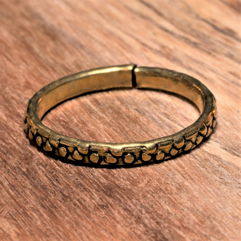 An adjustable, dainty pure brass dotted band toe ring designed by OMishka.