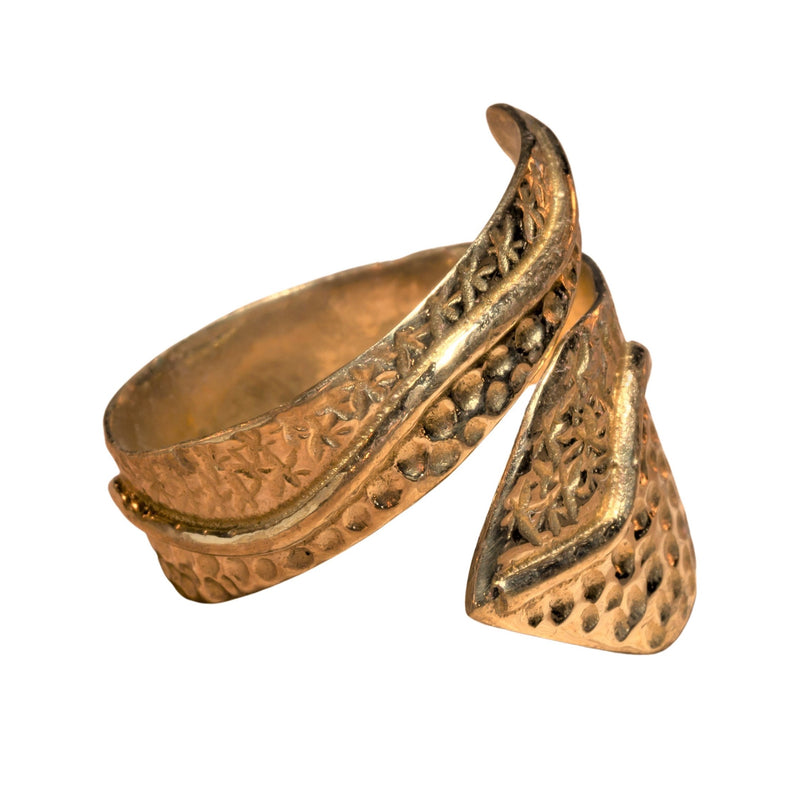 An adjustable, chunky, handmade pure brass, dotted star patterned wrap ring designed by OMishka.