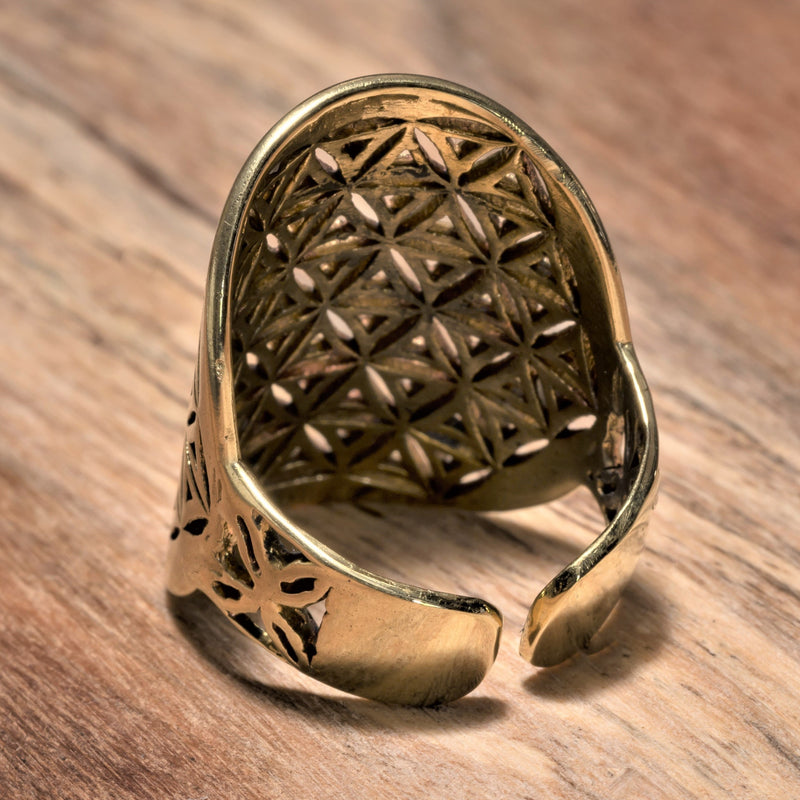 An adjustable, chunky, handmade pure brass flower of life ring designed by OMishka.