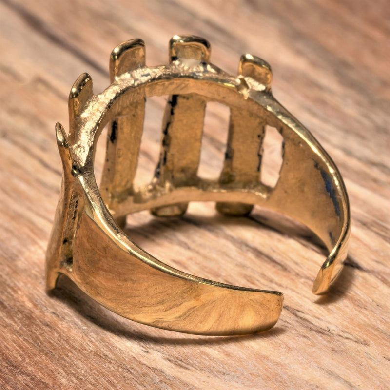 An adjustable, handmade pure brass, open line striped ring designed by OMishka.