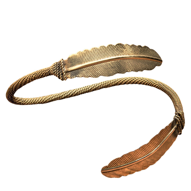 An adjustable, handmade double feather pure brass wrap bracelet designed by OMishka.