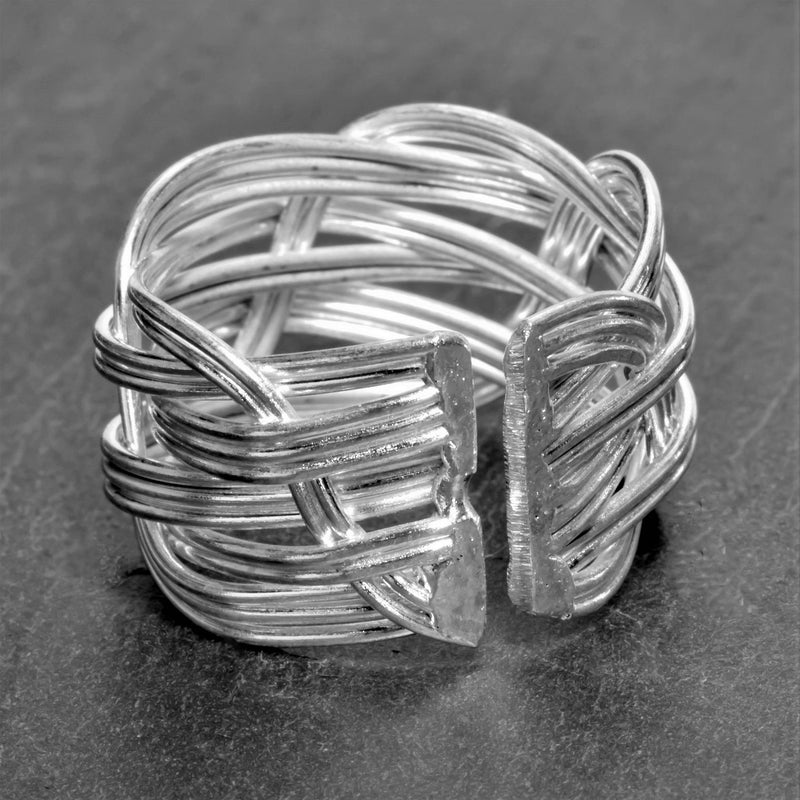 An adjustable, handmade and chunky, open weave plaited solid silver ring designed by OMishka.