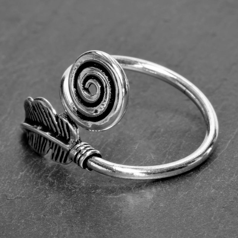 An adjustable, handmade solid silver, feather spiral wrap ring designed by OMishka.