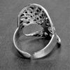 An adjustable, handmade solid silver, open tree of life ring designed by OMishka.