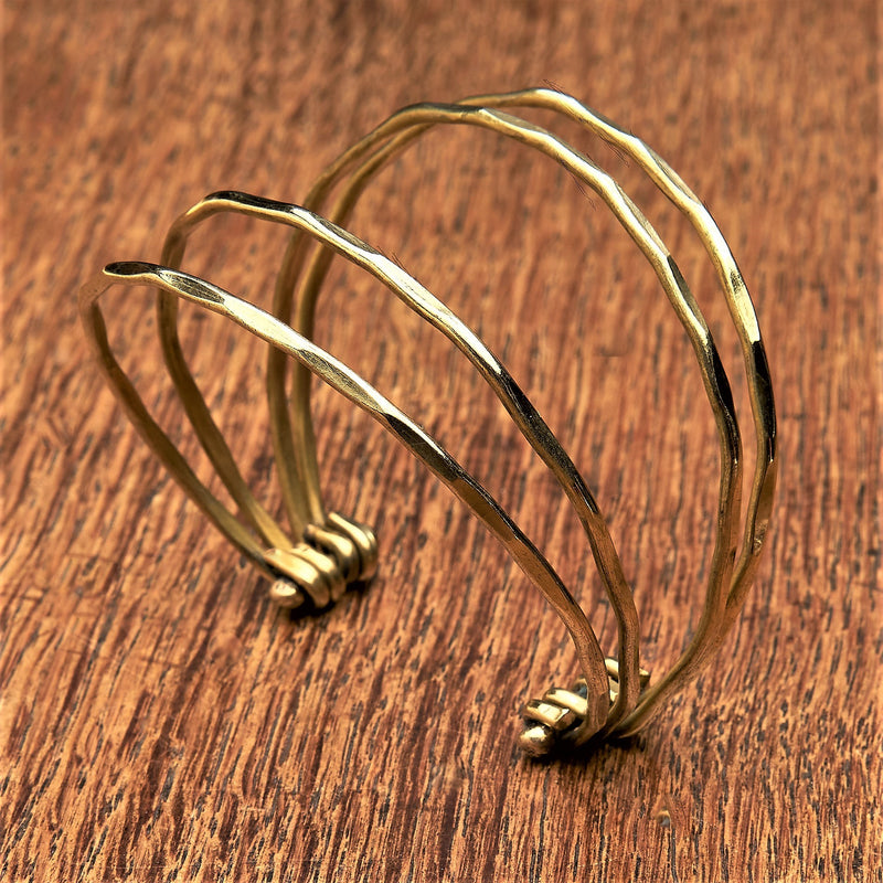 A delicate, adjustable multi strand pure brass cuff bracelet designed by OMishka.