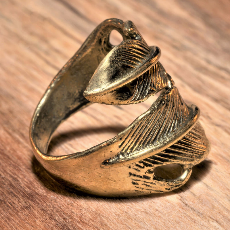 An adjustable, nickel free pure brass, double feather wrap ring designed by OMishka.