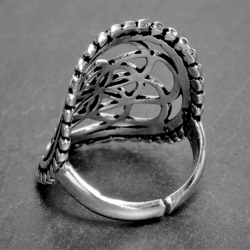 A large, adjustable, nickel free solid silver, beaded seed of life ring designed by OMishka.