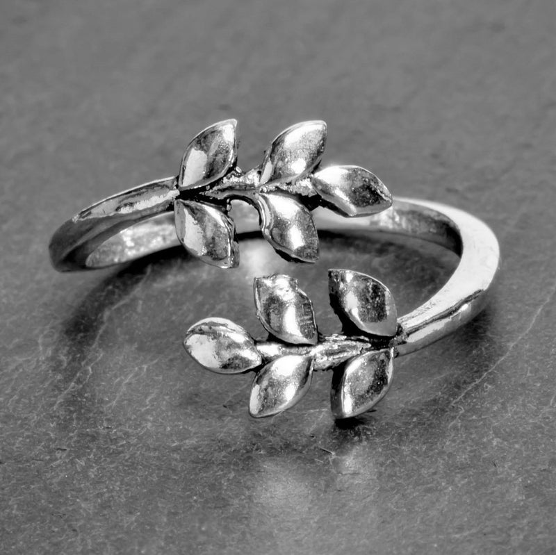 An adjustable, nickel free solid silver, dainty laurel leaf wrap ring designed by OMishka.