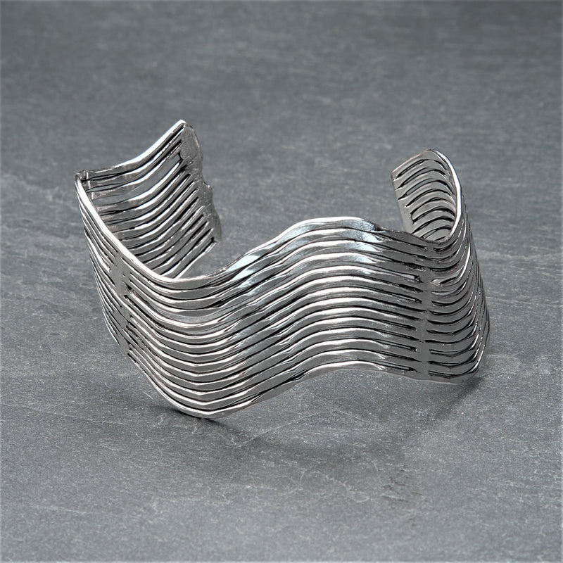 An adjustable, solid silver wavy cuff bracelet designed by OMishka.