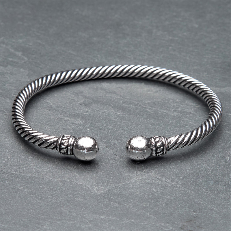 An adjustable, twisted silver rope cuff bracelet designed by OMishka.