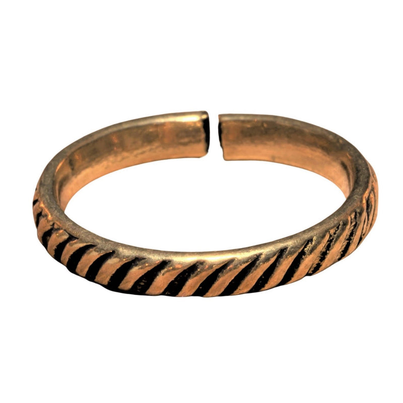 An artisan handmade, adjustable, dainty pure brass striped patterned band toe ring designed by OMishka.
