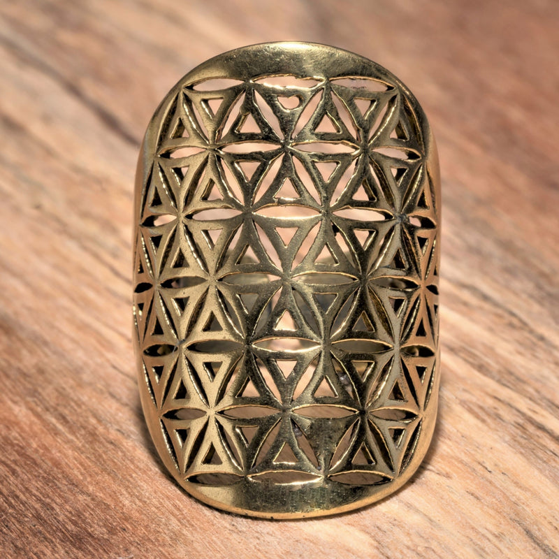 A large, adjustable, artisan handmade pure brass, flower of life ring designed by OMishka.