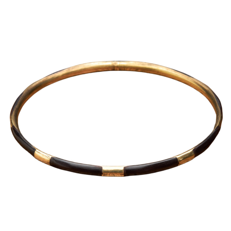 An artisan handmade, pure brass and black enamel striped thin bangle bracelet designed by OMishka.