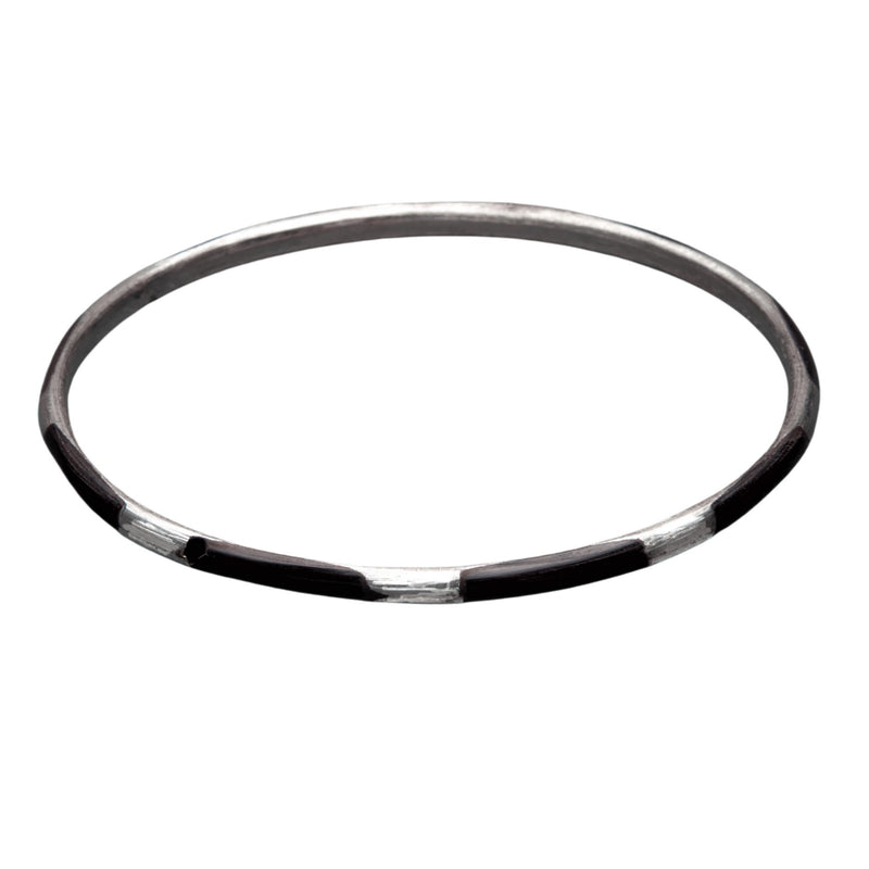 An artisan handmade, thin, silver and black enamel striped bangle bracelet designed by OMishka.