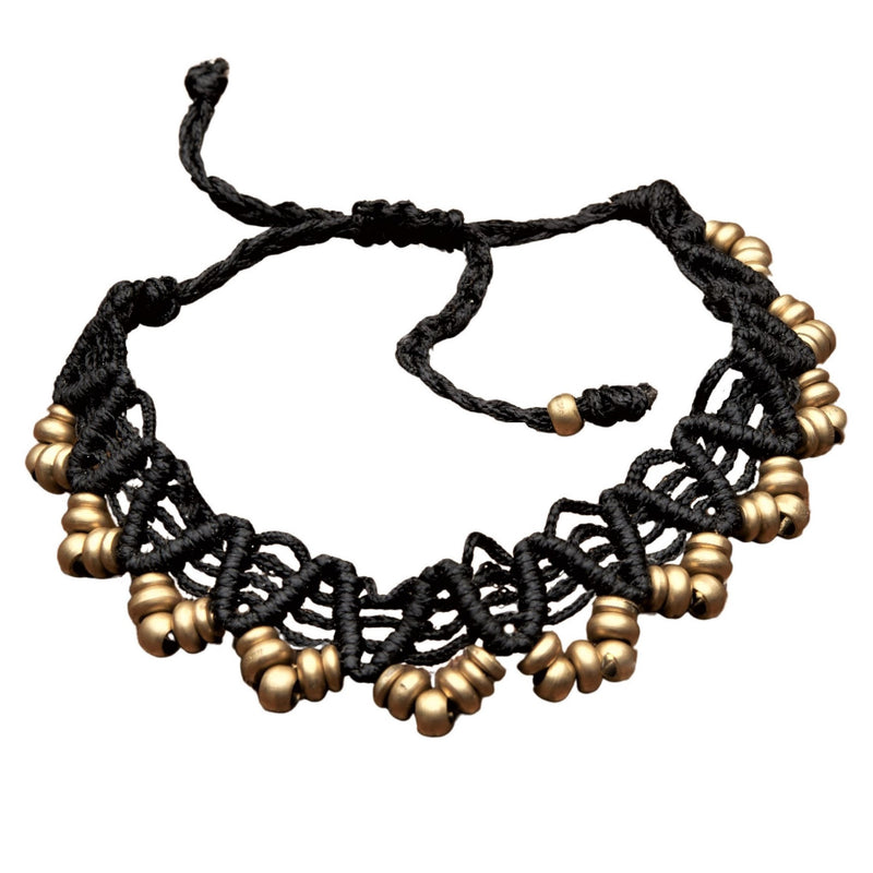 An artisan handmade, pure brass beaded macrame weave anklet designed by OMishka.