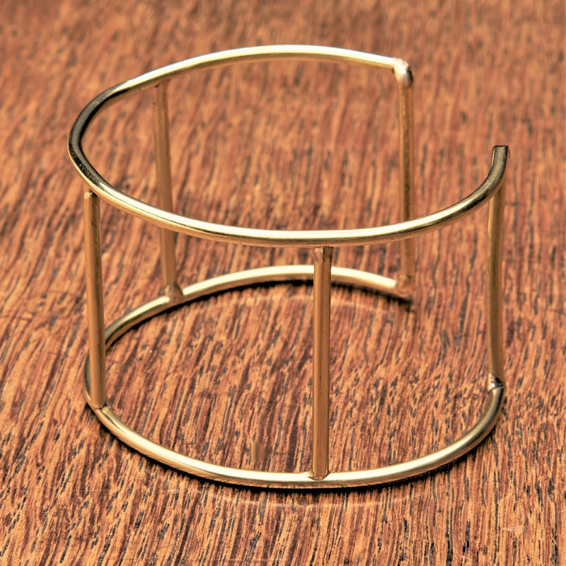 An artisan handmade pure brass, cut out square shaped cuff designed by OMishka.