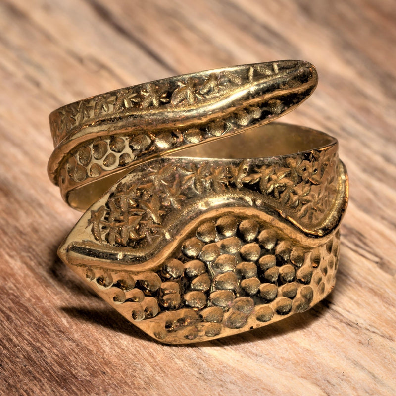 An adjustable, chunky, artisan handmade pure brass, dotted and swirl patterned wrap ring designed by OMishka.