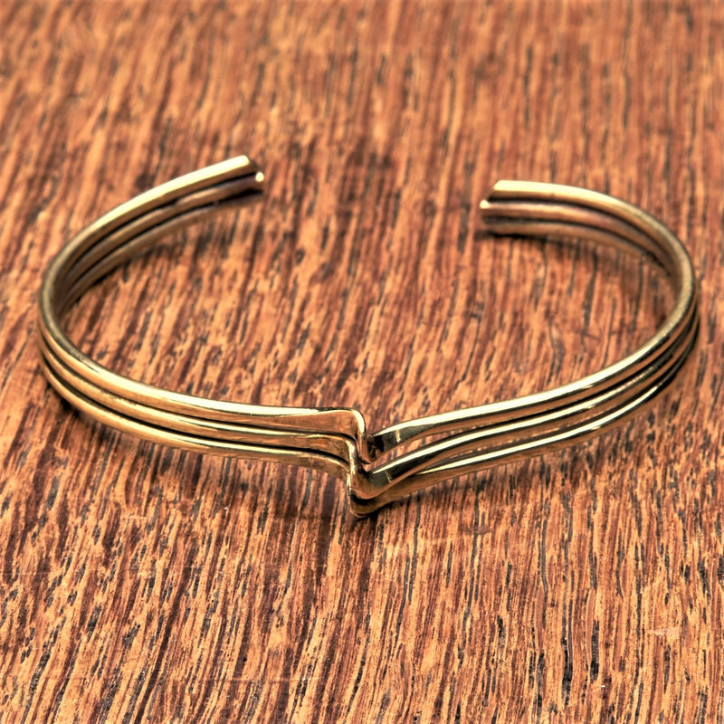 An artisan handmade, pure brass triple wave bracelet designed by OMishka.