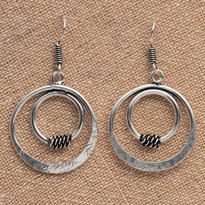 Artisan handmade solid silver, double nested circle, drop hook earrings designed by OMishka.