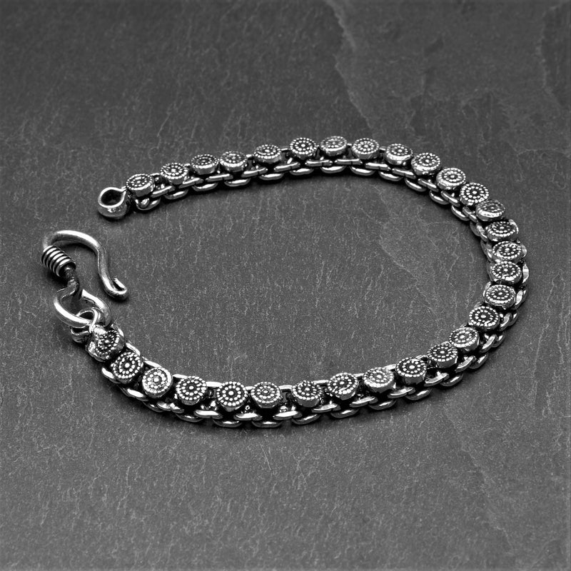 Artisan handmade silver toned brass, Banjara Tribe, slim and decorative disc chain link bracelet designed by OMishka.