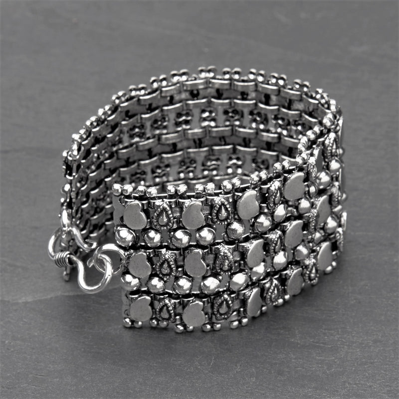 Artisan handmade silver toned brass, beaded and mango motif patterned, tribal chain bracelet designed by OMishka.