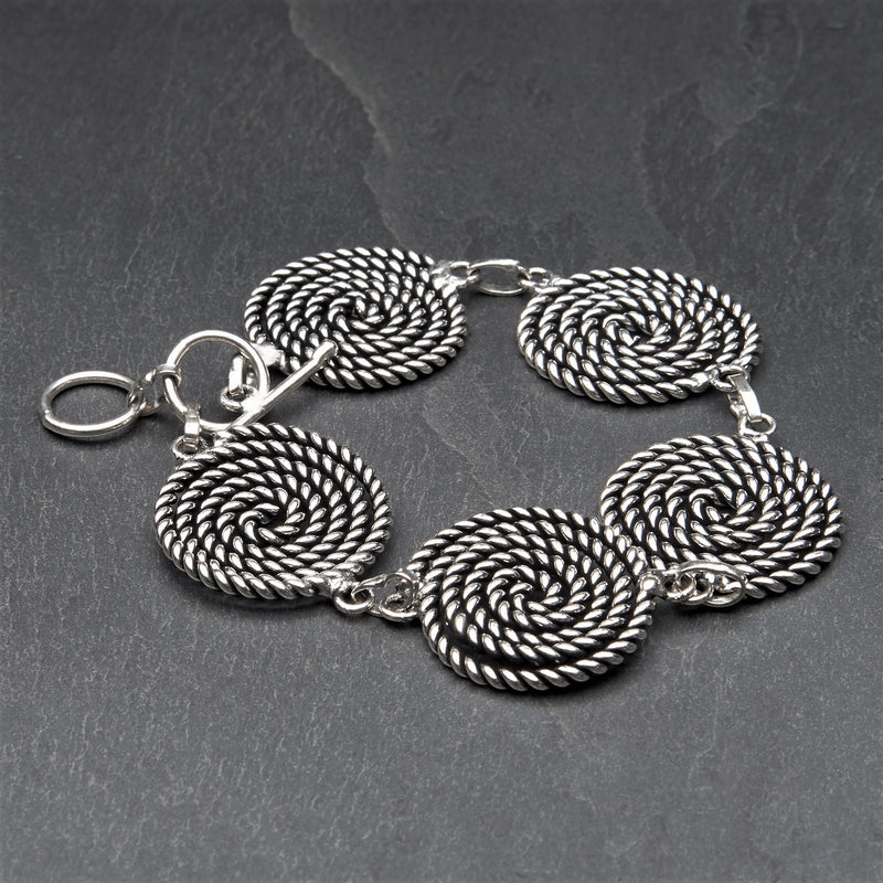 Artisan handmade silver toned brass, five coiled rope spiral detail, adjustable bracelet designed by OMishka.