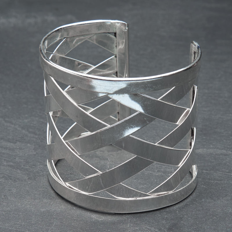 A wide artisan handmade silver, open lattice criss cross detailed cuff bracelet designed by OMishka.