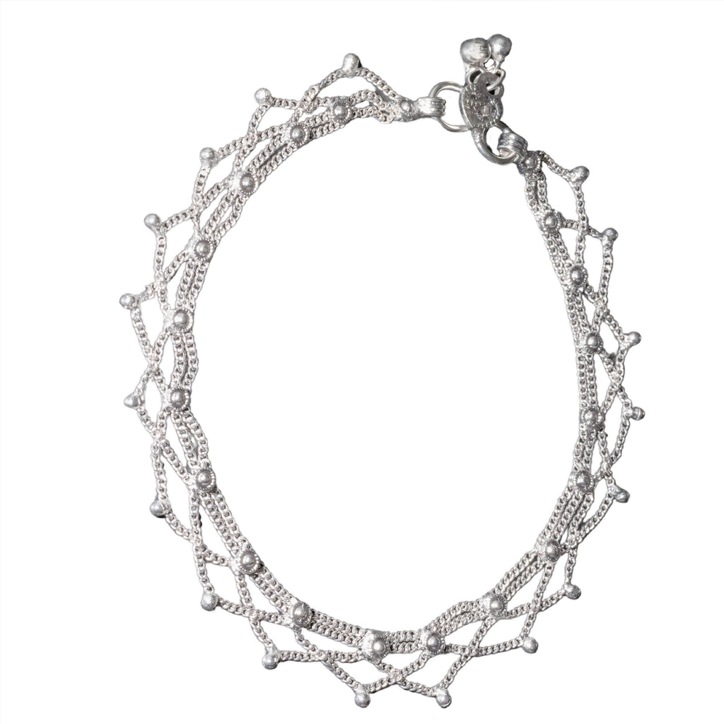 An artisan handmade solid silver, fancy beaded ankle chain designed by OMishka.